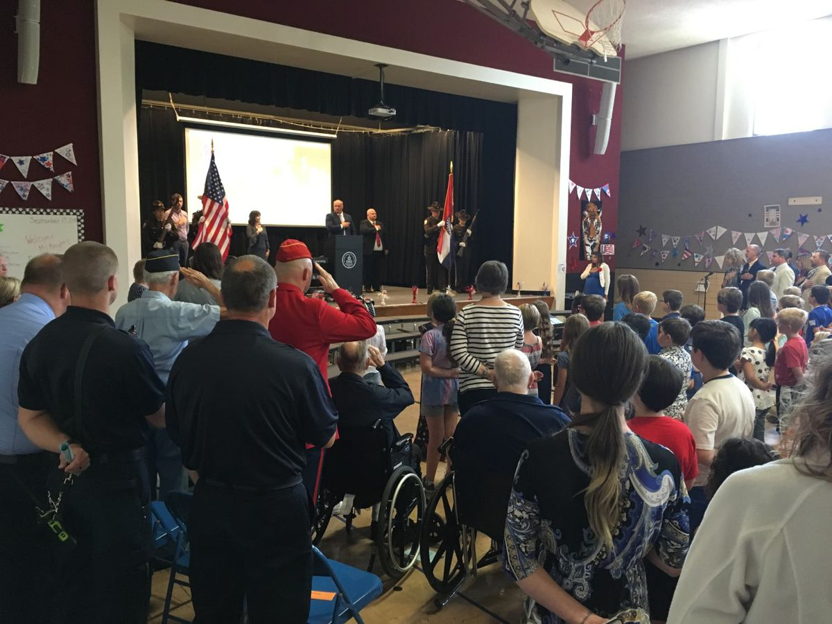Alma Schrader students honor heroes at assembly